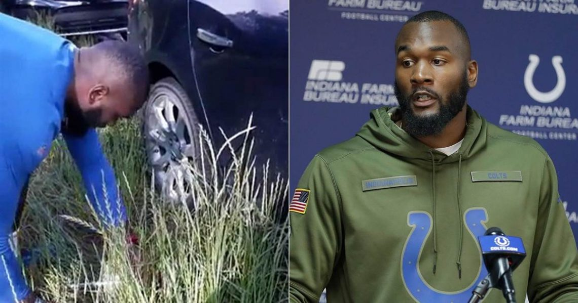 NFL Player helps change tire
